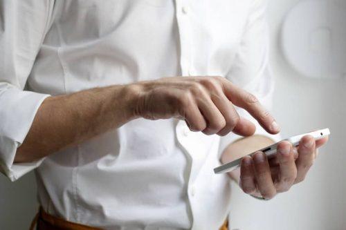 hands holding a smart phone