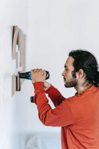 person using a cordless drill