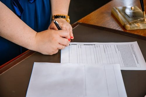person filling out forms