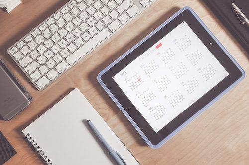 white keyboard, notebook and iPad