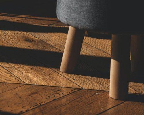 wooden stool on hardwood floor